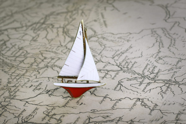 A Gold And Enamel Sailboat Pin