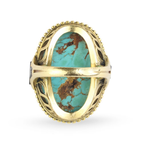 An Egyptian Revival Turquoise, Onyx and Gold Ring