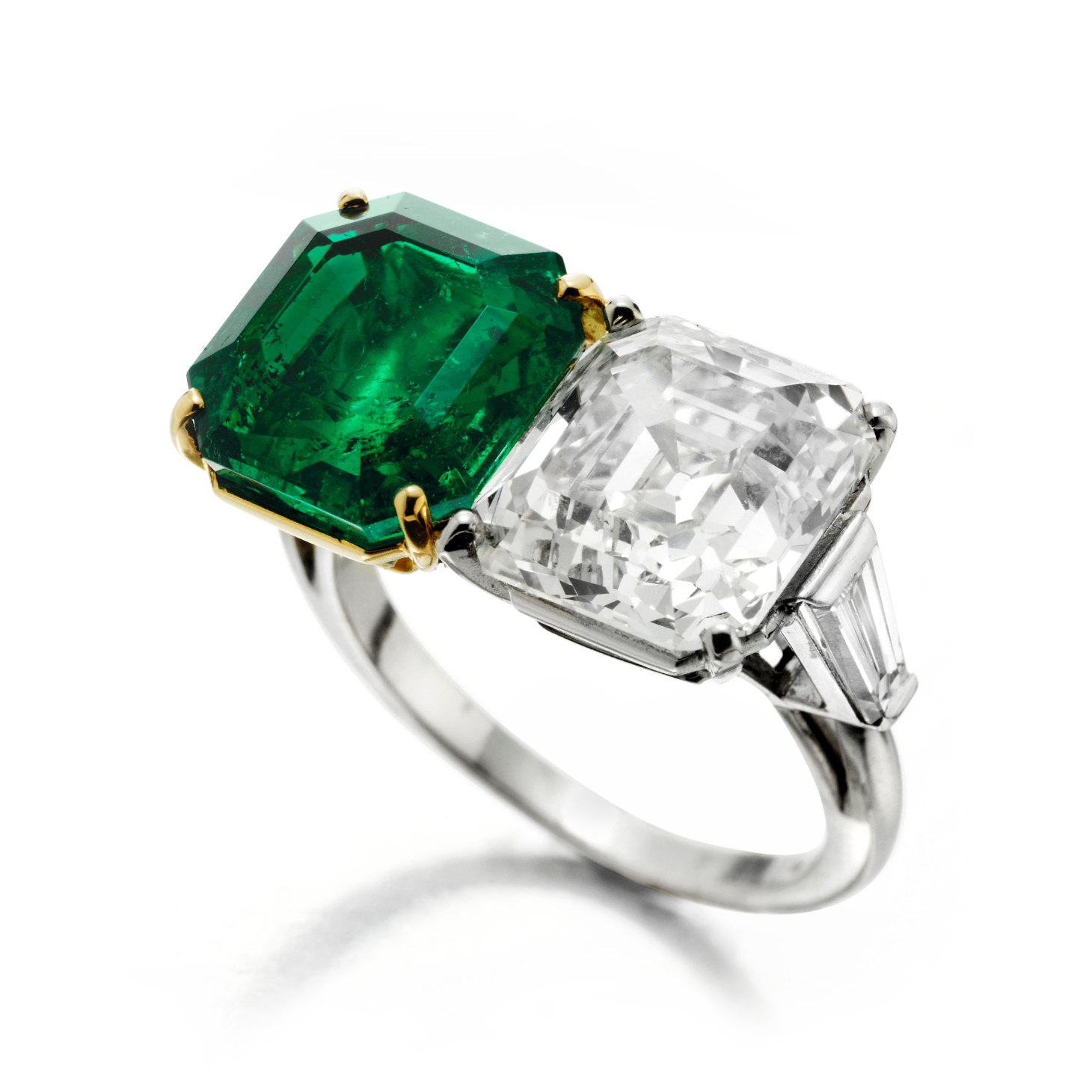 An Early 20th Century Emerald and Diamond Twin Stone Ring
